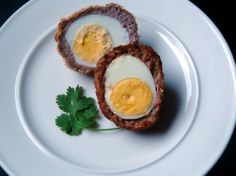 Hardboiled eggs, wrapped in sausage and breadcrumbs. An easy, make-ahead, protein-packed snack that can be fried or baked.