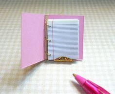 Tiny pink notebook