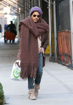 only a man like lenny kravitz can sport a very big scarf with jeans tucked in those suede mocassin-like half boots and look so cool.