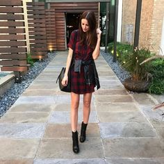 The Miller affect in a Madewell plaid shirt dress, a leather jacket, and leather booties