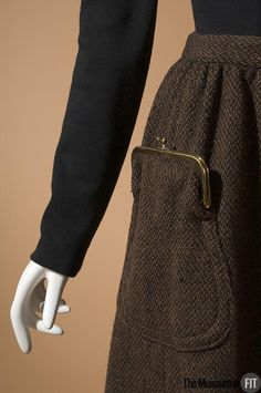 Vintage 1961 Bonnie Cashin dark brown tweed skirt with purse-detail pocket <3 | Museum at FIT New York
