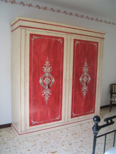 red and cream armoire