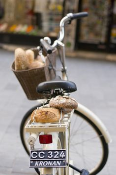 swimminginaseaoftea:  Two of my favorite things: bread and bicycles!