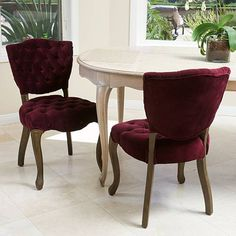 For a French inspired design, look no further than the Violetta tufted velvet fabric dining chairs. This set of two chairs offers ample tufting, a solid weathered oak frame, and intricately carved wooden legs.FeaturesSet includes 2 chairsUpholstered with 100% cotton velvet fabric in dark purpleCarved weathered wood frameTufted back and seat with button accentsPlush seat cushion for maximum comfortSturdy oak hardwood frame for stability and years of useIncludesDimensions (in inches)Dining…