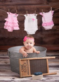 Photo shoot of baby girl in washtub