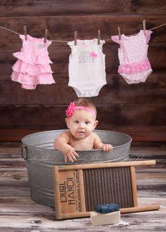 Photo shoot of baby girl in washtub
