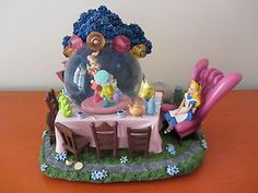 Disney Snowglobe - ALICE IN WONDERLAND - Mad Hatter's Tea Party - EXTREMELY RARE. $299.00