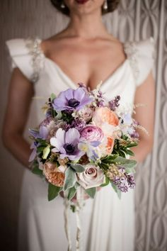 Purple Anemone & Peach Rose Bridal Bouquet // Pinned by Dauphine Magazine x Castlefield - Curated by Castlefield Bridal & Branding Atelier and delivering the ultimate experience for the haute couture connoisseur! Dauphine Magazine (luxury bridal and fashion crossover): www.dauphinemagazine.com, @dauphinemagazine on Instagram, and @dauphinemag on Pinterest • Visit Castlefield: www.castlefield.co and @ castlefieldco on Instagram / Luxury, fashion, weddings, bridal, style, art, design, jewelry