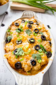 I have a husband that would love this!!! Tater Tot Enchilada Bake