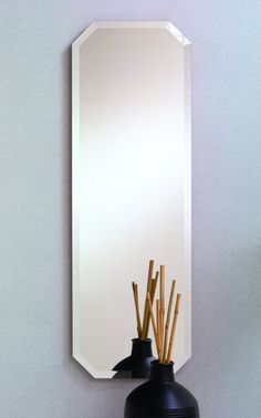 315 – Elongated octagon frameless mirror with 1″ beveled edge.16″ wide, 48″ high and 3/8″ deep.