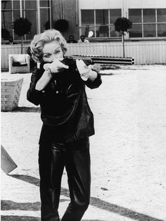 Marlene Dietrich. with a gun... that is why i love this picture.