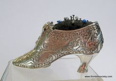 Silver shoe pin cushion
