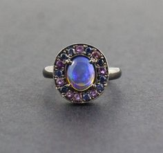 Australian jelly opal with amethyst and blue sapphire halo in