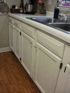 Beadboard wallpaper was added to the fronts of the cabinet doors and then painted with Valspar Signature paint and primer. Polyurethane was used as a final...