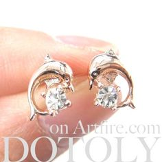 A pair of classic dolphin shaped stud earrings in rose gold! They are small and…