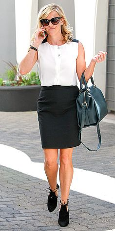 Love Her Outfit! | REESE WITHERSPOON | A white button-down and a black pencil skirt have never felt less blah. Reese breathes new life into the work staples with a sleeveless version of the top (featuring black accents on the shoulders) and adding high-fashion accessories: cutout lace-up Aquazzura booties, mod Thierry Lasry shades, and a Lanvin Trilogy bowling bag.