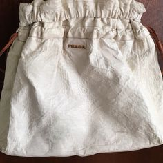 """Prada lambskin large shoulder bag in cream/ivory. Super soft leather ivory color Prada shoulder tote with drawstring.16"""" tall, 17"""" long at bottom, 4 1/2"""" at base. There are some dark marks on leather from use (see pics). Otherwise this is a beautiful bag! 100% authentic Prada Bags Shoulder Bags"""
