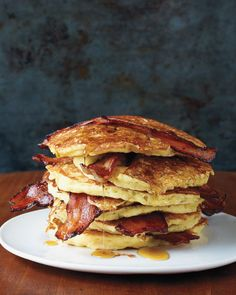 prettygirlfood:  Bacon Pancakes Ingredients 1 cup all-purpose flour, (spooned and leveled) 2 tablespoons sugar 11/2 teaspoons baking powder 1/2 teaspoon baking soda 1/2 teaspoon coarse salt 11/4 cups buttermilk 2 tablespoons unsalted butter, melted 1 large egg 8 slices bacon Pure maple syrup, (optional) Directions