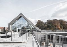 Concave roof of this Copenhagen cultural centre creates a form which blends in with the hilly landscape.