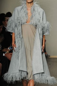 Pale blue-gray knee-length coat with elbow sleeves and feather trim. Donna Karan Spring 2013