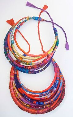 beautiful fabric necklaces from scrap fabric, contrasting floss or thread - so much color - try making these!