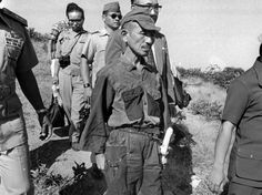 In March of 1974, some 29 years after the official end of World War II, Hiroo Onoda, a former Japanese Army intelligence officer, walks out of the jungle of Lubang Island in the Philippines, where he was finally relieved of duty. He handed over his sword (hanging from his hip in photo), his rifle, ammunition and several hand grenades. Onoda had been sent to Lubang Island in December of 1944 to join an existing group of soldiers and hamper any enemy attacks.