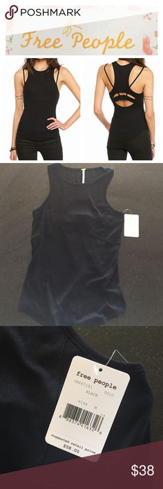 Free People tank top Free People black ribbed knit tank top, size medium.  Adjustable bra strap in keyhole back.  NWT. Note the model is wearing a bralette with skinny straps in the 1st pic. Free People Tops Tank Tops