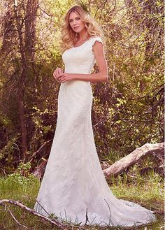 Maggie Sottero - madison, This modest sheath wedding gown features cascades of soft lace appliqués, a scoop neckline, and demure cap-sleeves. Scalloped lace accents the neck and hemline. Finished with covered buttons over zipper and inner elastic closure. Sheath Wedding Gown, V Neck Wedding Dress, Modest Wedding Dresses, Perfect Wedding Dress, Bridal Dresses, Sottero And Midgley Wedding Dresses, Designer Wedding Gowns, Quinceanera, Cap Sleeves