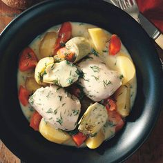 """Potatoes, artichokes, and carrots """"beef"""" up this Greek Chicken and Vegetable Ragout dish made with chicken thighs for just 450 calories per serving. #chickenrecipes #healthyrecipes #healthyeating #everydayhealth 