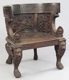 Italian Carved Walnut Barrelback Armchair, mid-19th c., inspired from Roman Classical designs with Renaissance embellishments,