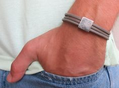 """Men's Bracelet - Men's Geometric Bracelet - Men's Gray Bracelet - Men's Leather Bracelet - Men's Jewelry - Bracelets For Men - Gift for Him  Looking for a gift for your man? You've found the perfect item for this!   The simple and beautiful bracelet combines 3 gray leather bands with a silver plated square element.  The bracelet clasp is easy to use and safe.   Length: 7.6"""" (19.5 cm) + 2"""" (5 cm) extension chain. $32"""