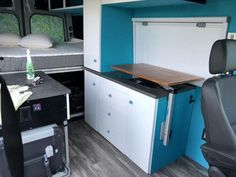 DIY campervan shelf that swings out to use as a table!,DIY campervan shelf that swings out to use as a table! This is one of the coolest designs that I have seen! The article is full of tips trick. Camper Hacks, Diy Camper, Rv Hacks, Van Conversion Interior, Camper Van Conversion Diy, Rv Storage Solutions, Storage Hacks, Easy Storage, Storage Ideas