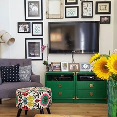 Still need to hide those awful cords. When we have major projects like removing walls and electrical, the little projects, like hiding the TV cords in the wall, tend to fall on the back burner. Still loving the emerald green DIY tv stand I made this spring. One of the great parts about this house is the fact that it has 2 living rooms. So I can have one living room all dark and moody with wood tones and the other one much more airy and bright filled with color. This TV console project fits…