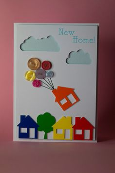 This lovely handmade new home card inspired by the film Up features house floating away on button balloons. Lovely unique card to celebrate a new