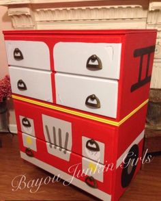 Fire truck dresser painted in 9 different colors from HTP and DIY paints! Bayou Junkin