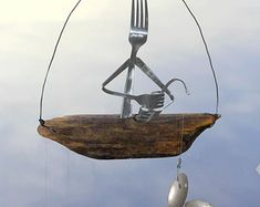 Fork Fisherman And Driftwood Dingy With Silver Spoon Fish Wind Chime,vintage Spoon Lure, Unique Angler Gift, Sport Tournament, Fork Folkart Fishing Spoons, Recycled Metal Art, Fish Man, Fish Fish, Twisted Metal, Fish Sculpture, Fish Swimming, Fish Design, Upcycled Vintage