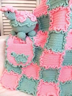 This beautiful set will delight any new Mom and baby!!!! Made from worsted weight yarn will make it easy to care for. Each square of the baby blanket has it's own ruffle, so once you have sewn it together, there is no need to put an edging on it
