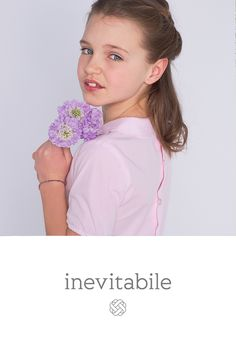 INEVITABILE KIDS FASHION SS17 : The Perihan blouse: This pink blouse with a Claudine collar is made of very light cotton poplin and closed at the back by 5 pretty mother-of-pearl buttons. It's classic design is embossed on the front with a sun shaped embroidery inspired by traditional Turkish motifs.