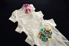 bows, lace trim and fabric flowers added to onesies