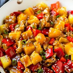 Pineapple chicken stir fry in a skillet, topped with sauce, sesame seeds and green onions. Pineapple Chicken Stir Fry, Pineapple Chicken Recipes, Chicken Over Rice, Chicken Parmesan Recipes, Easy Chicken Recipes, Asian Recipes, Chinese Recipes, Chinese Food, Hawaiian Chicken