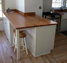 beadboard island and wood looking counter...kinda cool?  Also has a lighter wood floor.  Looks pretty.