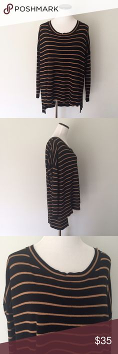 """THE LIMITED Black gold stripes hi low Sweater Black and gold stripes hi low Sweater. Length in front 24.5"""", back length 29"""". Chest 25"""" across. Oversized sweater. Rayon and nylon. The Limited Sweaters"""