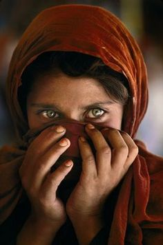 Steve McCurry. A variant on McCurry's famed Afghan girl portrait