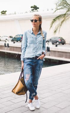 Janni Deler looks ultra cool in this denim on denim style which consists of dark denim jeans, and a lighter denim shirt. This look is great worn with casual white sneakers and a leather bag.Shirt: Lindex, Jeans: Chiquelle, Bag: Céline, Shoes: Superga.