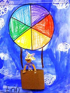 K- color wheel hot air balloon (9x12 blue paper, pre-print color wheel--cut out and glue), brown yarn for strings)