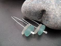 Sea glass jewelry,  Blue and white sea glass modern style earrings. $29.00, via Etsy.