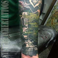 A photo-realistic tattoo piece of a serene waterfall nature scene by artist Steve Butcher. | Intenze ink