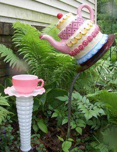 Garden teapot. http://www.etsy.com/listing/74864684/pouring-teapot-garden-totem