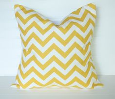 yellow chevron pillows for our grey couches = swoon.