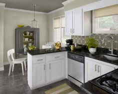 Classic Black And White Kitchen traditional kitchen white cabinets black countertops - google